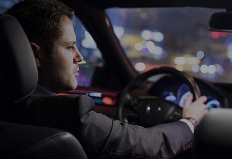 RI Car Service Driver Looking Over Shoulder