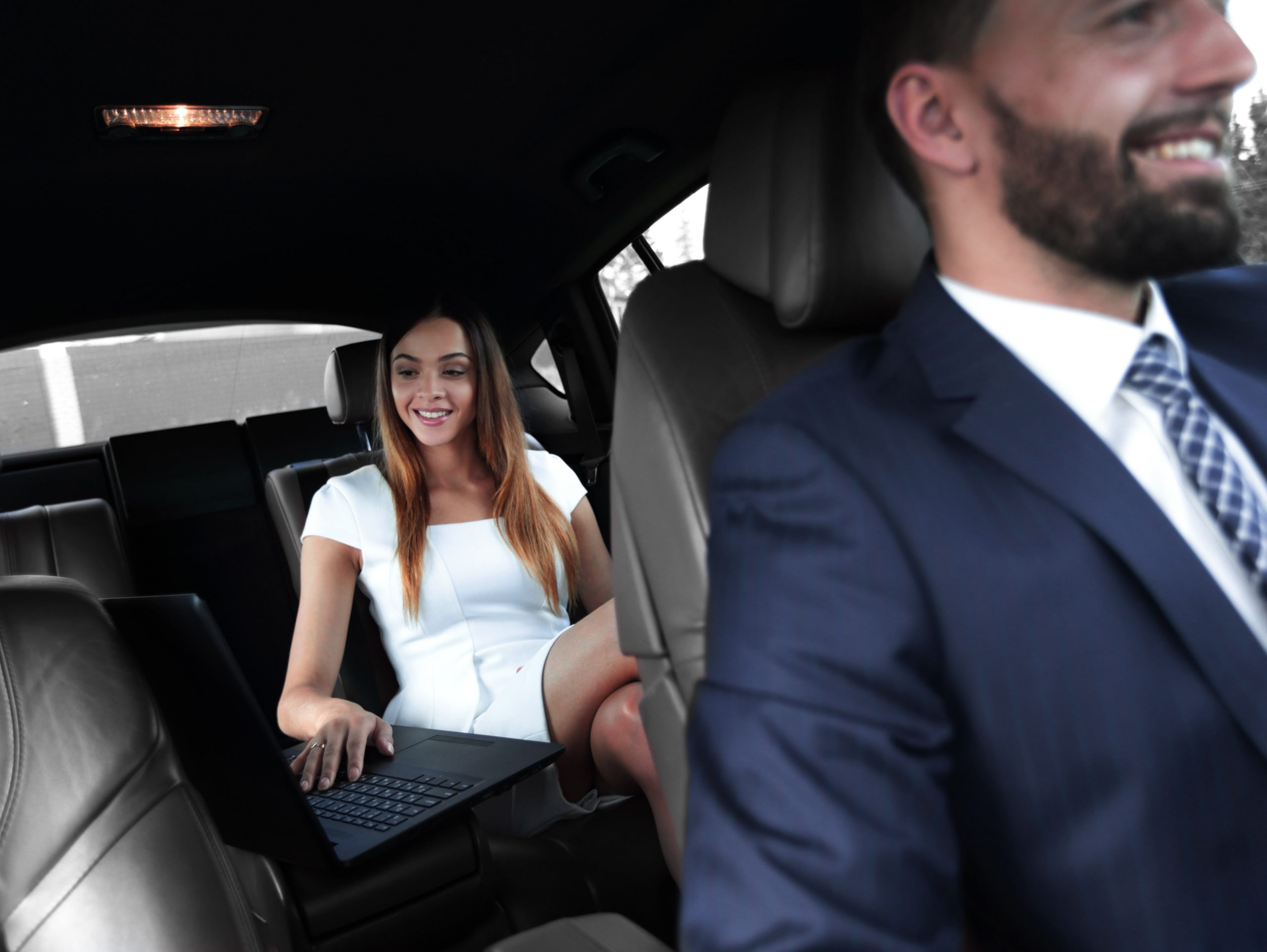 Woman in back seat of car