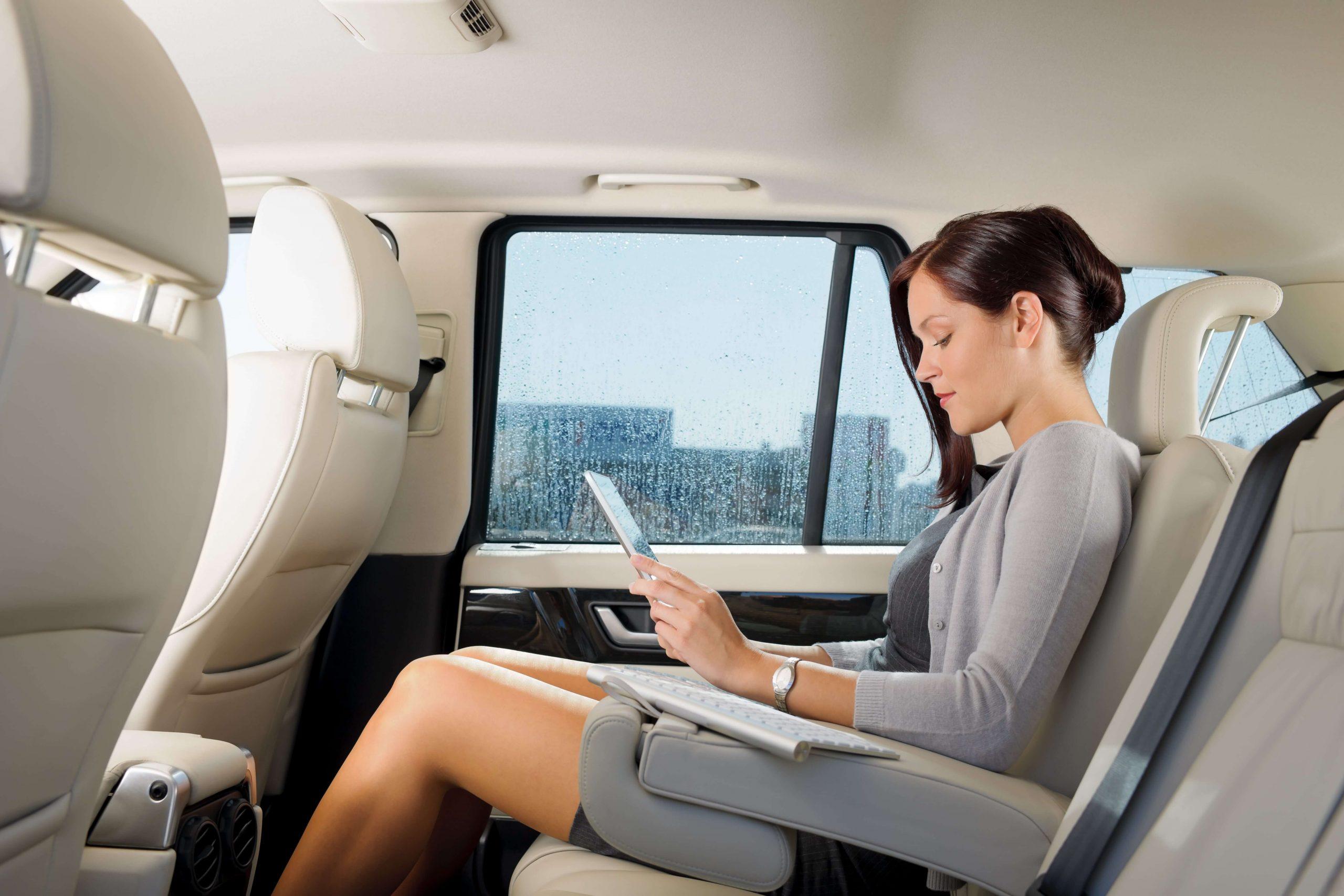 Women in backseat of car